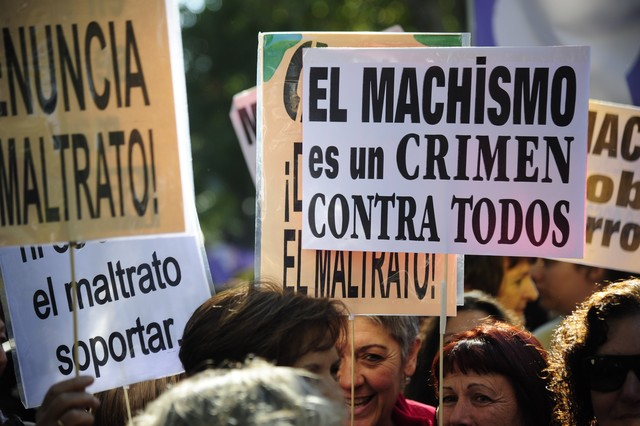 Demonstrators hold posters against gender violence during a demonstration against domestic violence outside the Health Ministry in Madrid on November 7, 2015. Twenty-five women and eight children (girls and boys) have been killed since the start of the year at the hands of a male family member, according to the Spanish department of health. AFP PHOTO / CURTO DE LA TORRE